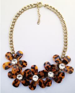 MODELO COI14001. Bonitas flores estampado leopardo para esos looks de otoño. 12€